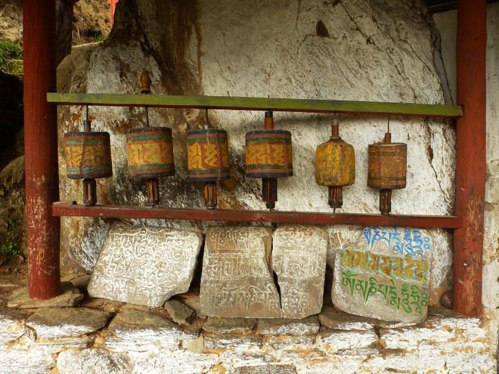 Prayer wheels outside 'Pema Sambhava' temple in the Bumthang valley, Bhutan.
