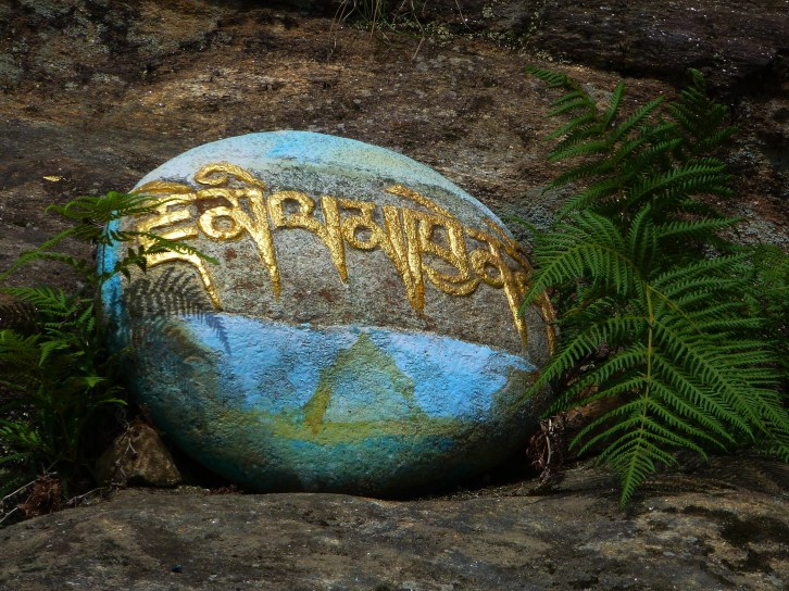 A mantra stone in Bumthang, Bhutan.