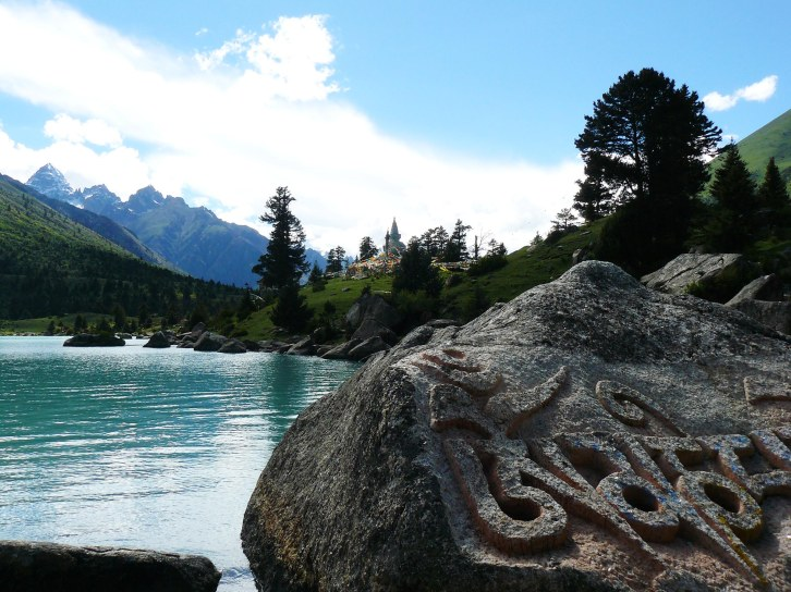 Mani boulders at 'Lha Tso' lake in Kham, Tibet. Possibly the most beautiful place I have ever been.