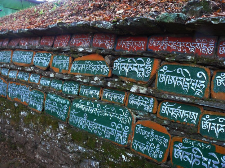 A Mani wall in Tashiding, Sikkim. The mani carver has made it his lifetime's work.